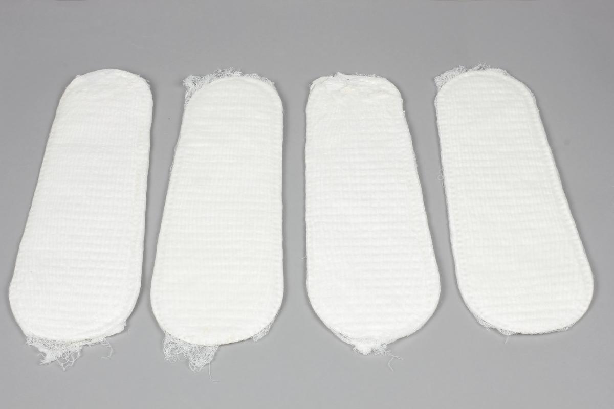 Bleie. Absorberende papir med et tynt lag bomull på den ene siden med tynn netting rundt.