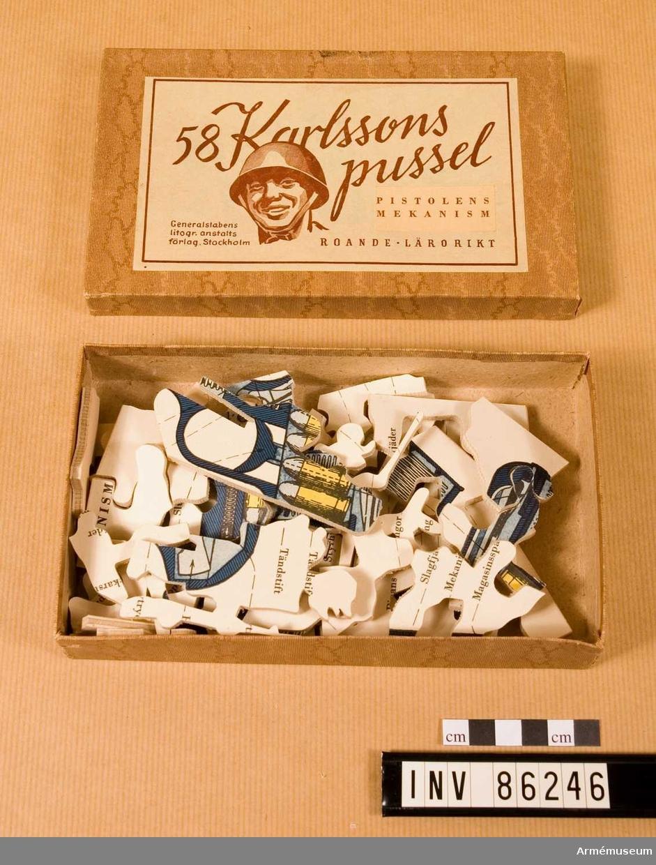 """58 stycken pussel föreställande pistolers mekanism.   58:an Karlssons pussel """"Pistolens mekansim"""""""