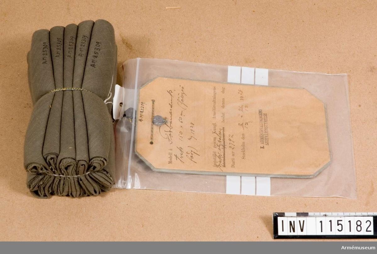Grupp I:II. Trekantig förbandsduk 150x60 cm, fältgrå, m/1928.