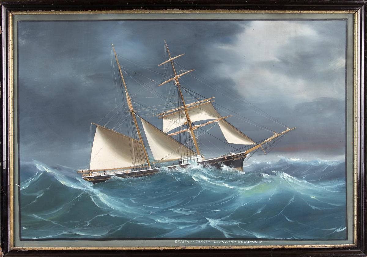 Skipsportrett av skonnertbrigg ERIKKA med delvis revet seil på opprørt hav. Ser en del av mannskapet i arbeid på dekk.