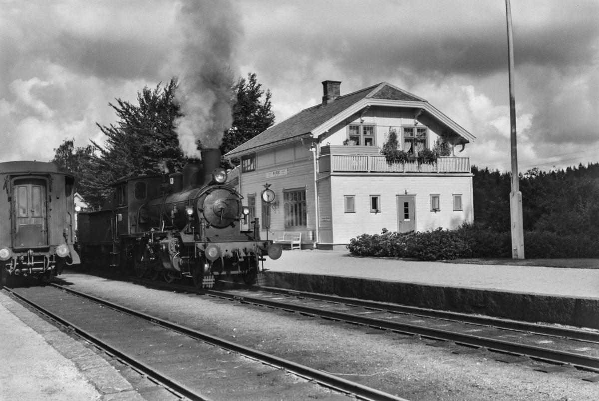 Godstog fra Grimstad til Arendal . Toget trekkes av damplokomotiv type 21c nr. 373.