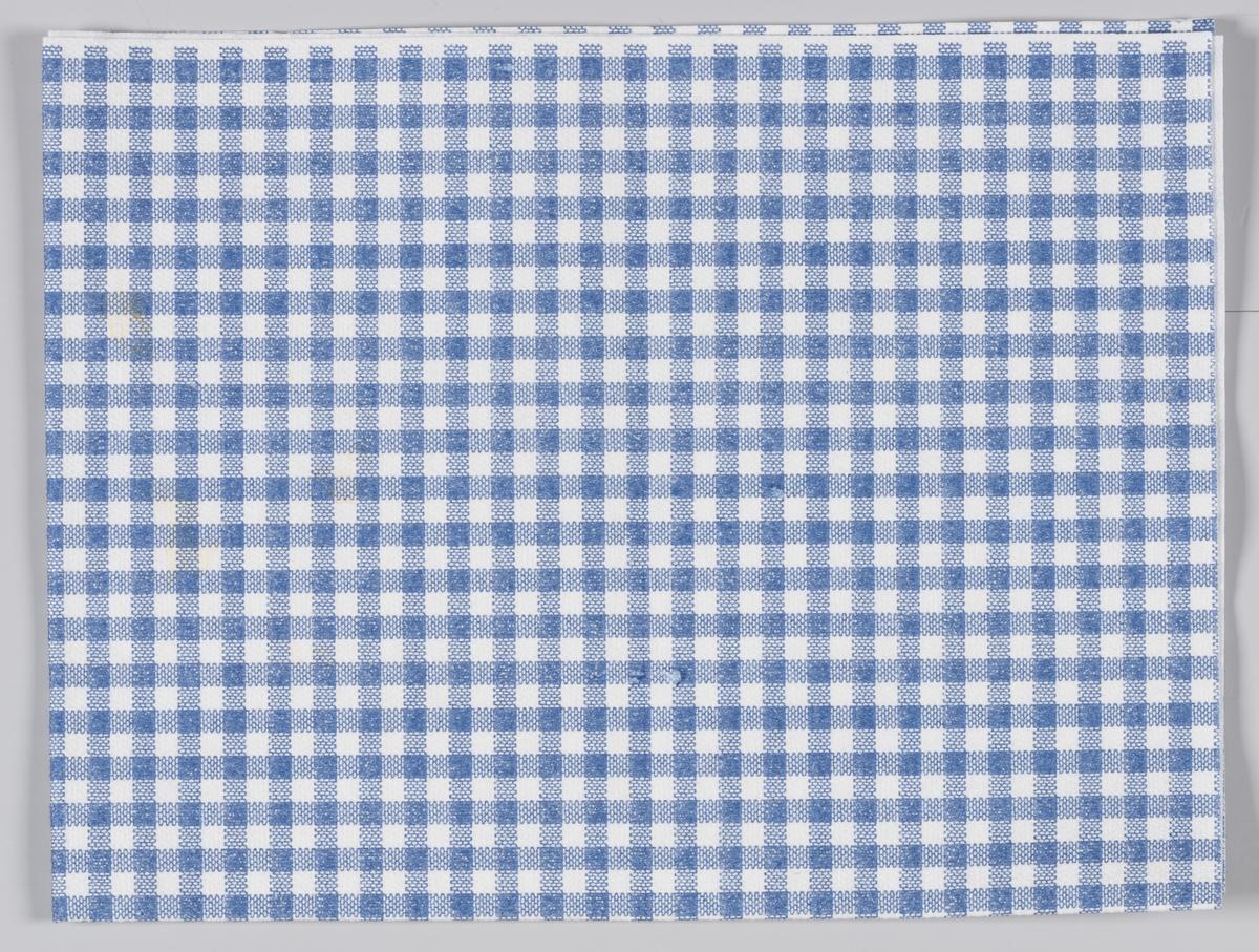 En blå og hvit rutete serviett fra en ukjent restaurant.