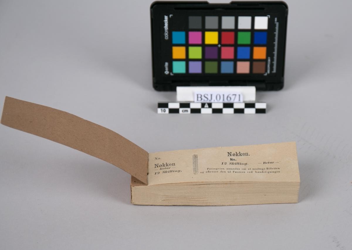 Billetthefte. Billettblokk fra passasjerbåt NØKKEN fra ca. 1872. Blokken inneholder ca. 250 billetter som kan rivest av.