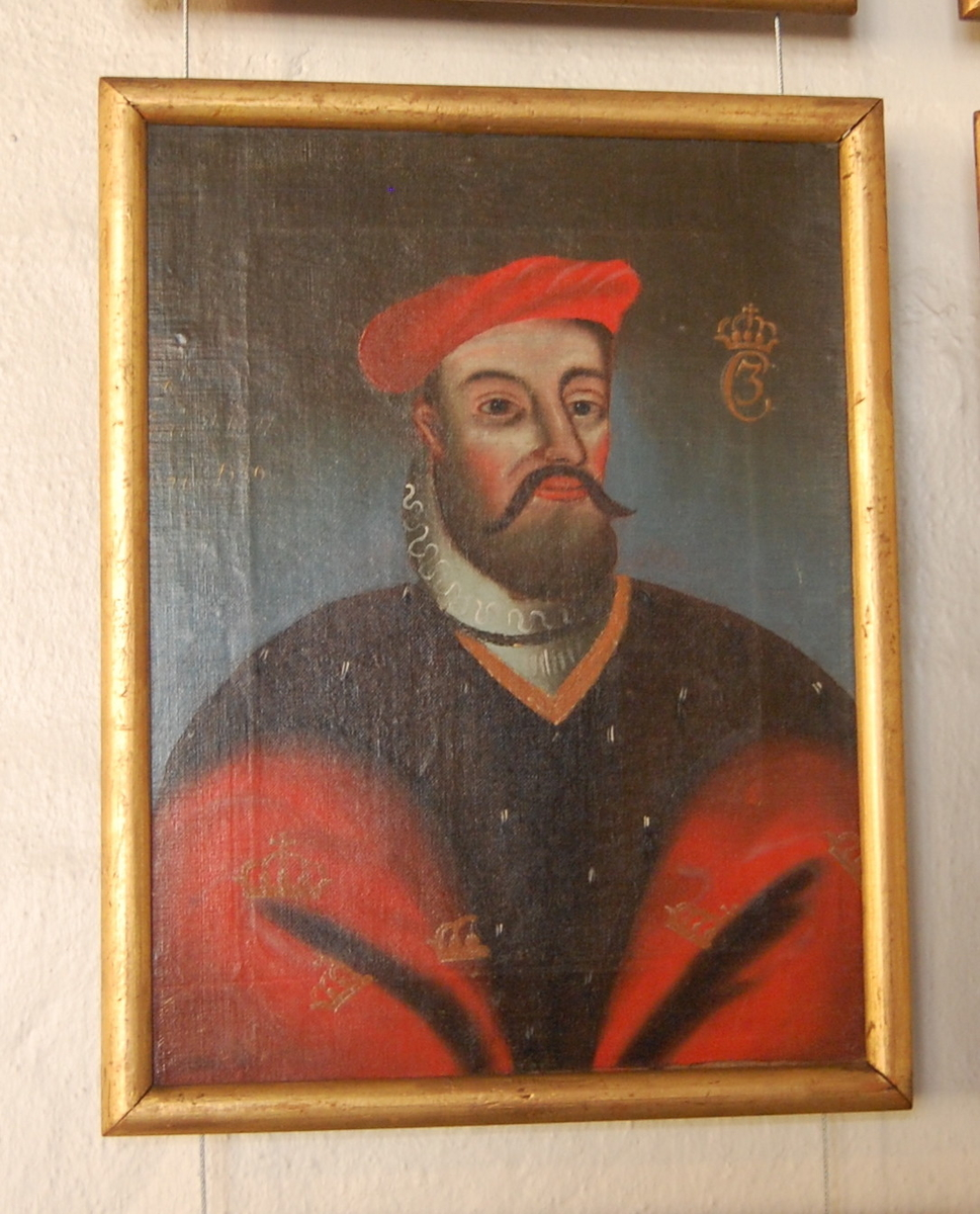 Portrett av Christian III. Olje på lerret. Halvfigur en face, hodet i kvart profil mot høyre. Rød kappe med gullkroner og brun pelskrave. Rød lue.
