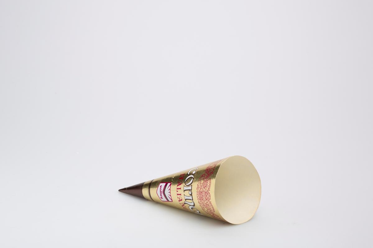 Kjegleformet iskrempapir (kremmerhus) i aluminium og papir. Kremmerhuset er med farger på utsiden, og uten farge (hvit) på innsiden. Iskrempapiret har gullfarget bakgrunn, med brun tupp. Midt på er det en stiplet rivekant. Rett under denne er det en logo. Øverst på papiret er det en  blomsterranke, under denne er det noe skrift.