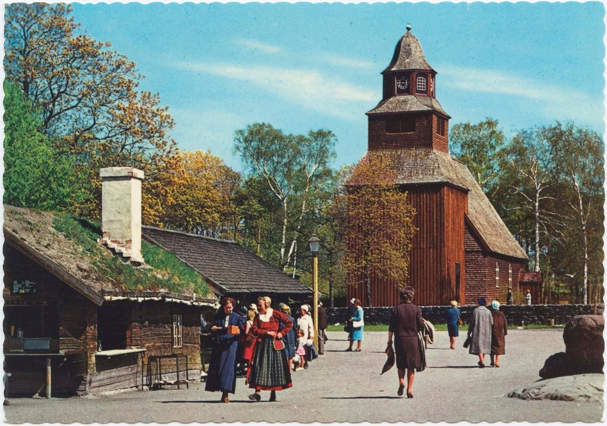 """Vykort med motiv från Skansen. """"Marknadsgatan och Seglora kyrka."""""""