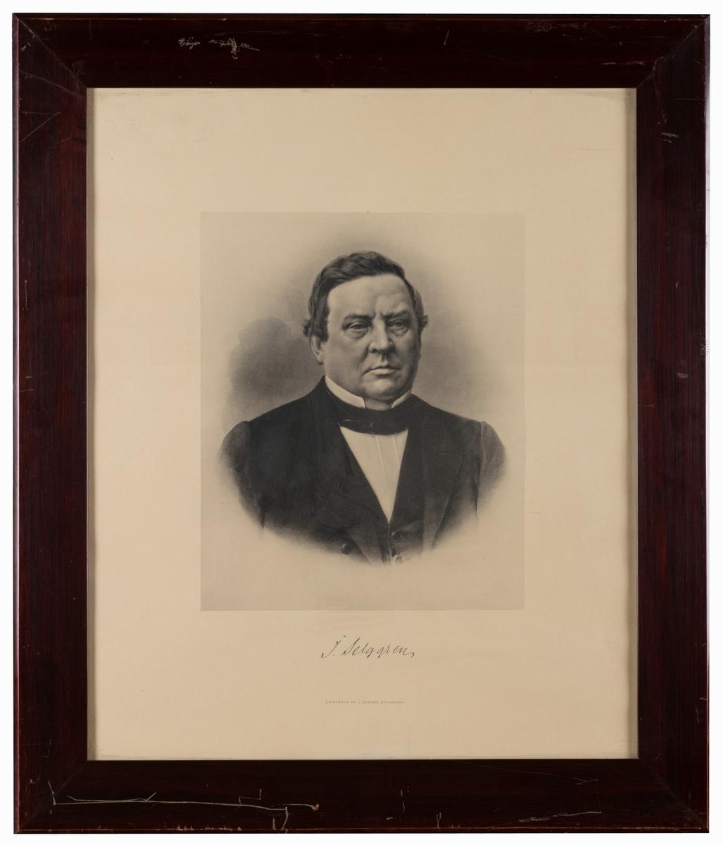 Porträtt, ljustryck, föreställande rektor J Selggren. Mahognyfärgad ram av trä.