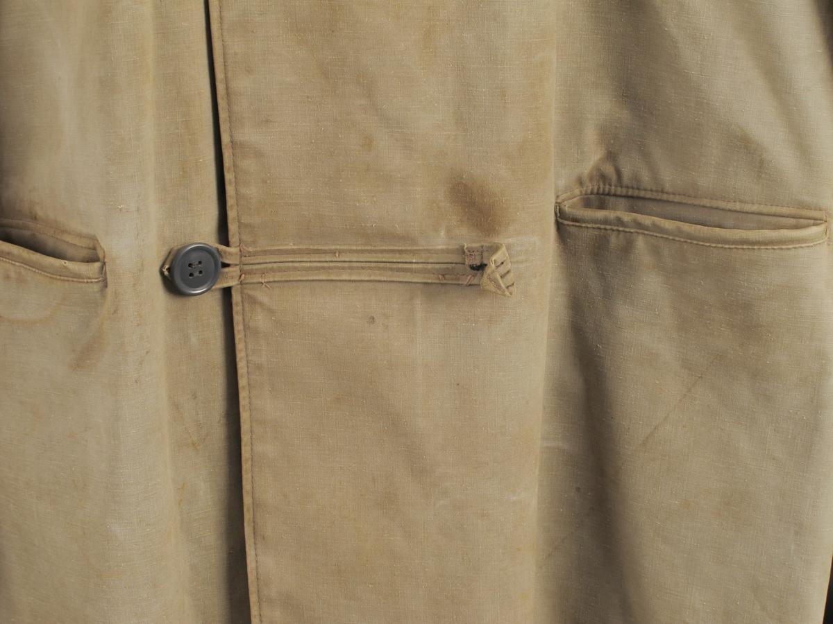 Regnfrakk  med hette.  Impergnert tekstilmateriale.