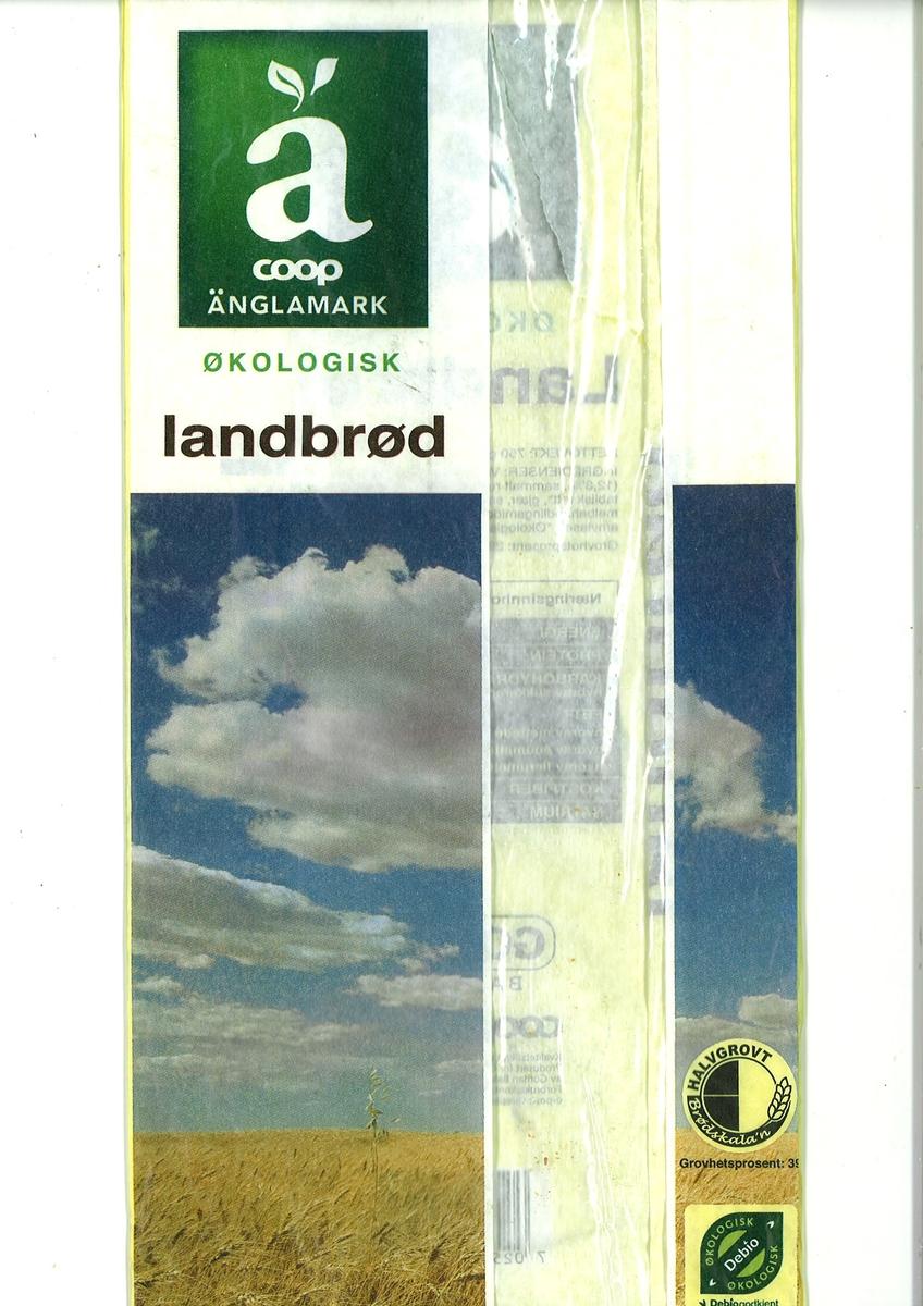 Motiv på posen er en åker med modent korn. Over åkeren ser man en blå himmel med hvite skyer