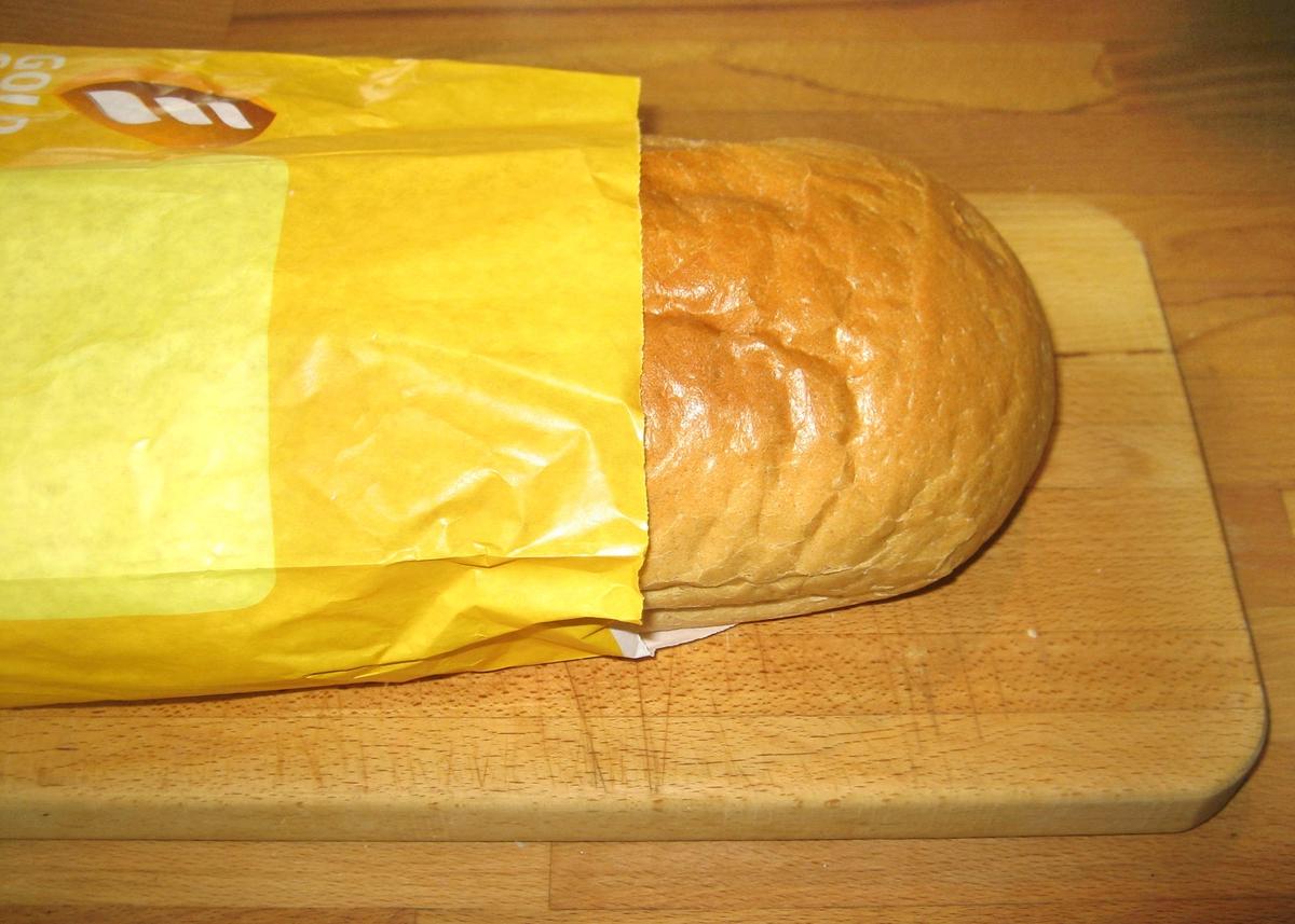 Forsiden: Et stilisert korn. Tegnet: Flere kornaks ved siden av hverandre som i en åker. Alt holdt i gule og oransje nuanser